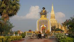Man prays at statue King Setthathirat, That Luang,Vientiane,Laos Footage