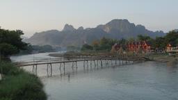 Kids on bicycle cross bamboo bridge,Vang Vieng,Laos Footage