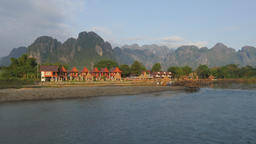 Karst mountains and bungalows with school kids,Vang Vieng,Laos Footage
