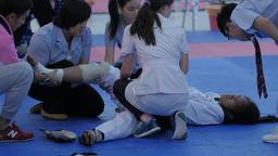 Medical staff taking care of injured taekwondo player,Ubon Ratchathani,Thailand Footage