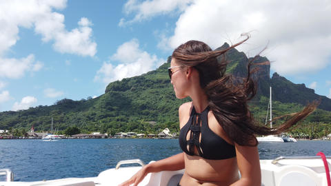 Speed boat sexy bikini travel woman enjoying ride on luxury speed boat vacation Live Action