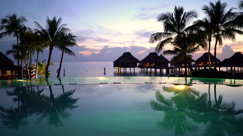 Pool vacation travel destination - beach, palm trees overwater bungalow hotel Footage