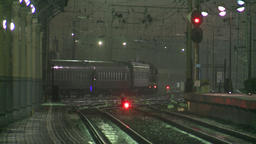 Moscow. Train station at night. The train departs from the station. Rain Live Action