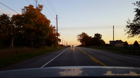 Rear View From Back of Car Driving Rural Countryside Road With Traffic During Day. Car Point of View Live Action