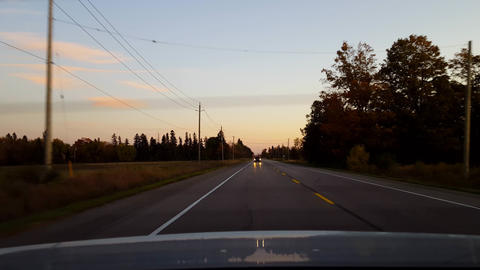 Rear View From Back of Car Driving Rural Countryside Road With Traffic During Day. Car Point of View Footage