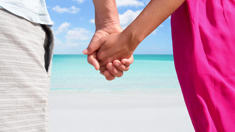 CINEMAGRAPH - seamless loop: Holding hands romantic newlyweds couple on beach Footage