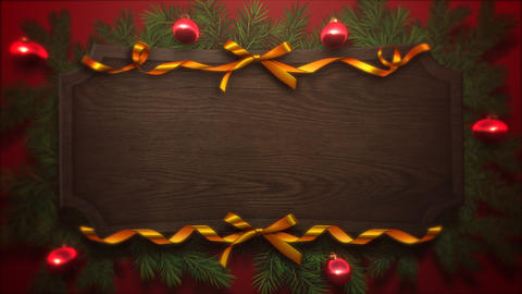 Animated close up red balls and Christmas green tree branches on wood background Animation