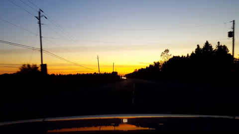 Rear View From Back of Car Driving Rural Countryside Road During Sunset or Sunrise. Car Point of Live Action