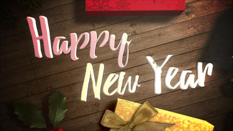 Animated closeup Happy New Year text, gift boxes and green tree branches on wood background Animation