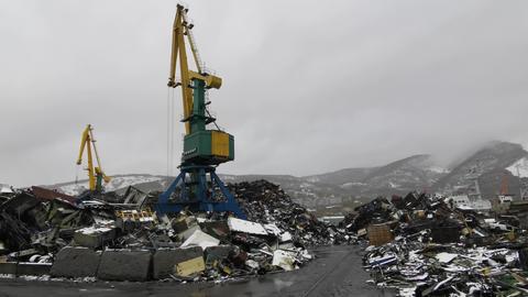 Cranes load scrap metal onto ships Footage