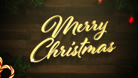 Animated closeup Merry Christmas text, colorful garland and Christmas green tree branches on wood Animation