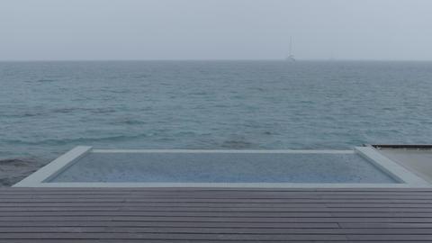 LOOP VIDEO: Rain on Vacation - video of luxury pool raining bad weather travel Live Action