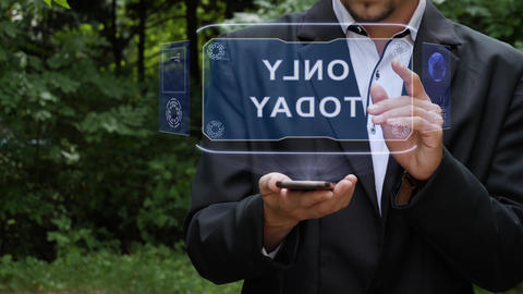Businessman uses hologram with text Only today Live Action
