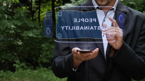 Businessman uses hologram with text People sustainability Footage