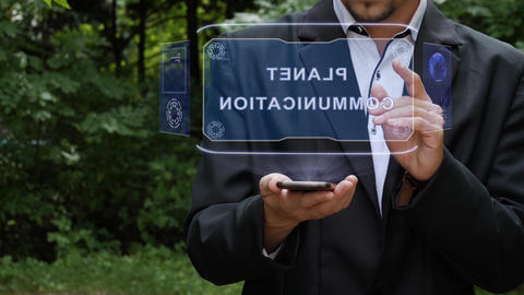 Businessman uses hologram with text Planet communication Footage