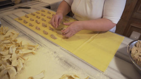 Woman manually prepares ravioli with meat filling - a traditional Italian dish Footage