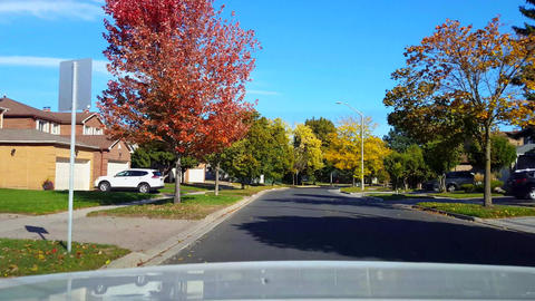 Rear View From Back of Car Driving Along Suburb Road in Day. Car Point of View POV Behind Vehicle Live Action