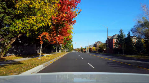Rear View From Back of Car Driving Along Road in Day. Car Point of View POV Behind Vehicle Bright Live Action