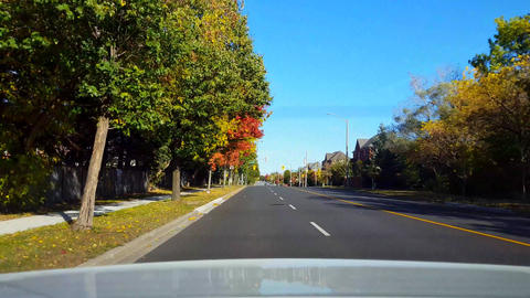 Rear View From Back of Car Driving Along Road in Day. Car... Stock Video Footage