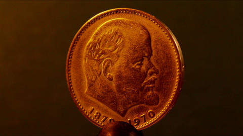 Coin with a profile of Lenin Live Action