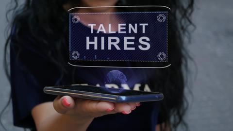 Woman showing HUD hologram Talent hires Live Action