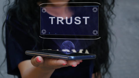 Woman showing HUD hologram Trust Live Action