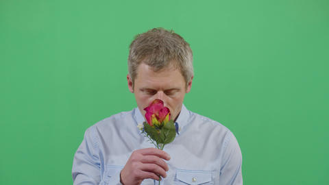 Studio Shot Of A Adult Man Smelling A Flower Live Action