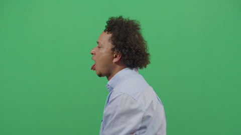 Lateral Shot Of A Adult Man Sticking Out The Tongue Footage
