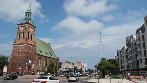 Saint Barbara Roman Catholic church in Gdansk, Poland. Saint Barbara church with busy street in Live Action