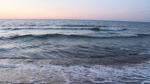 Ocean waves beat against waves on beach. Sea water. Beautiful waves of Baltic sea on sandy beach Footage