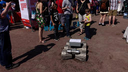 Boy control moon robot, kids study robotic rover at public science event Footage