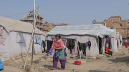 Woman washing clothes in refugee tent camp,Bhaktapur,Nepal Footage