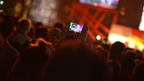 Fan making video by smart phone at concert Footage