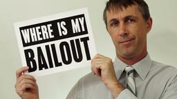 Businessman Where Is My Bailout Sign Footage