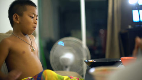 Asian boy eating rice at home Footage