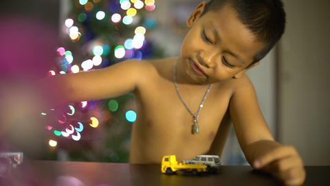 Little boy playing with toy cars in living room Footage