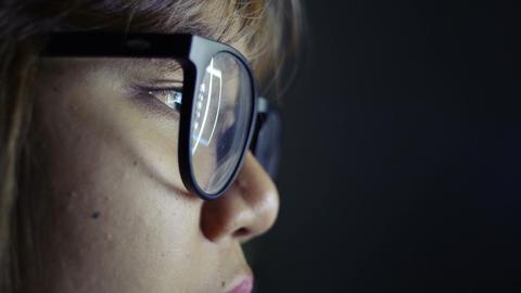 Woman wearing glasses serfing internet Footage