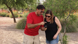 Two Adults Play Augmented Reality Game on Smartphone Stock Video Footage