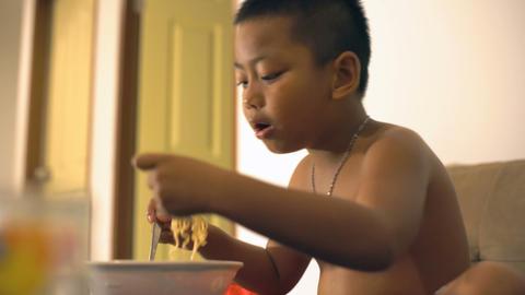Thai boy overeats instant noodles Footage