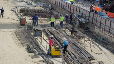 Workers near reinforcement for road reconstruction Footage