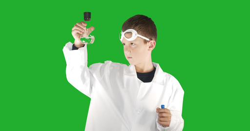 Boy scientist wearing white lab coat performing science experiment on background Footage