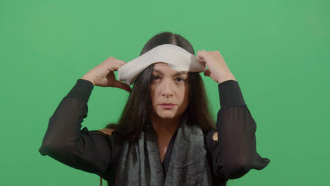 Woman Putting On A Blindfold Footage