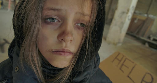 Close-up face of an exhausted Syrian refugee with dirty face falling asleep Live Action