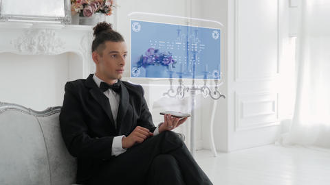 Young man uses hologram Venture Capital Live Action
