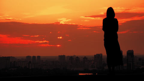 back view woman standing outdoors concept city view at sunset Live Action