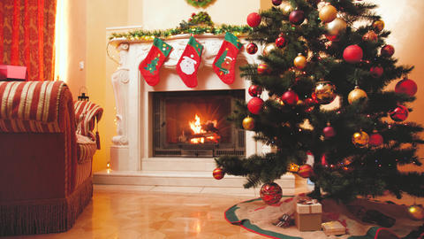 Toned 4k video of beautiful living room with fireplace decorated for celebrating Live Action