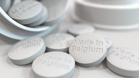 Pills with MADE IN BELGIUM text on them. National pharmaceutical industry Live Action
