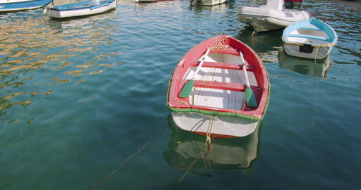 Red Wooden rowing boat in the port of Portofino, Italy, Europe Live Action
