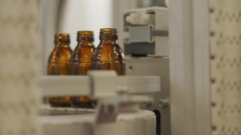 Empty bottles on conveyor belt, automated control system Footage