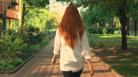 rear redheaded girl enjoy freedom have fun outdoors Live Action